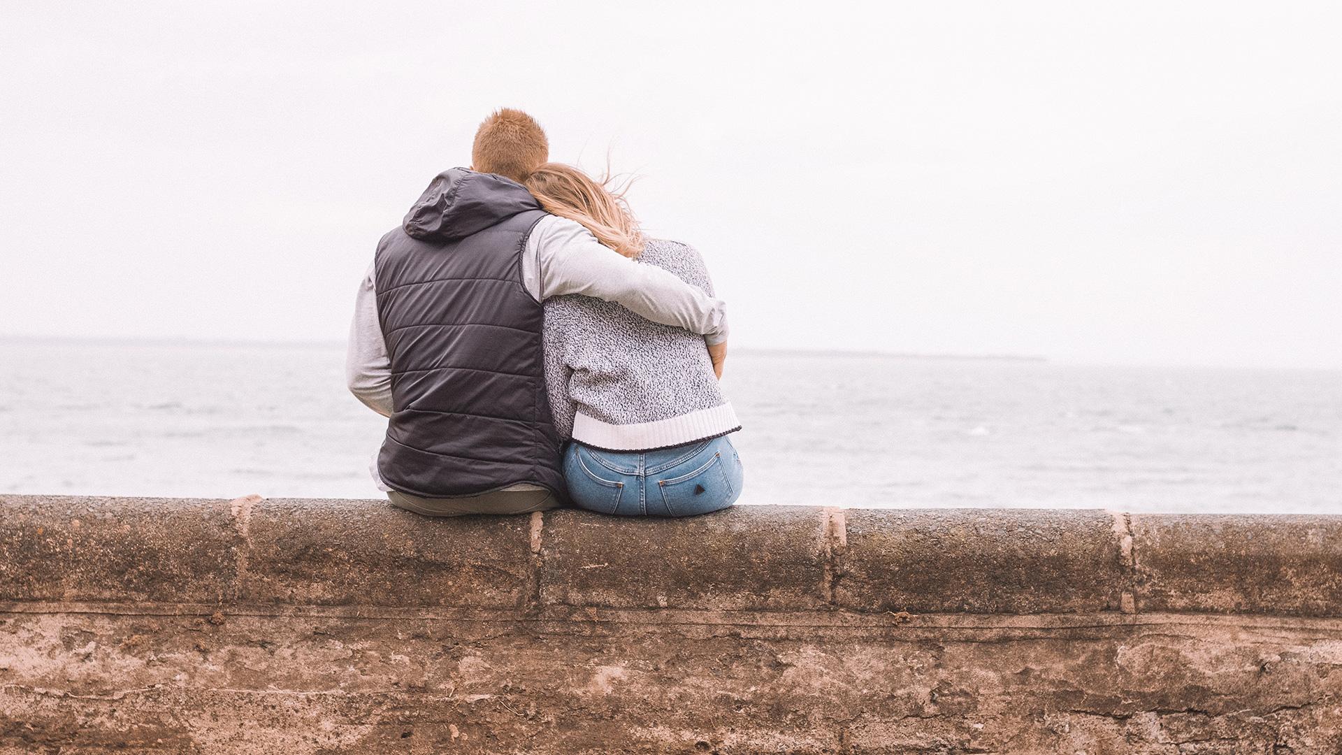 Couple-Sitting-at-Lake